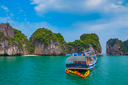 Cruise boat in Halong Bay, Vietnam, Southeast Asia. UNESCO World Heritage Site.
