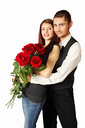 Young couple with bouquet a rose on a white background