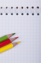 Royalty Free Photo of a Notebook and Pencil Crayons