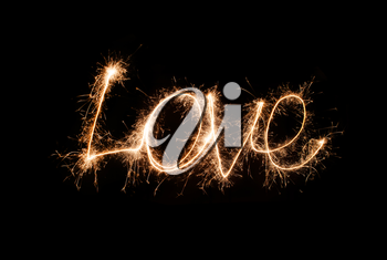 The inscription Love from sparklers
