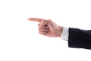 Businessman hand pointing to the left index finger on a white background.