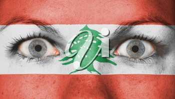 Close up of eyes. Painted face with flag of Lebanon