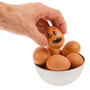 Scared egg, waiting to be grabbed by a hand, isolated