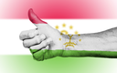 Old woman giving the thumbs up sign, isolated, flag of Tajikistan