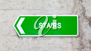 Green sign on a concrete wall - Stairs