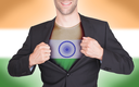 Businessman opening suit to reveal shirt with flag, India