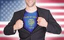 Businessman opening suit to reveal shirt with state flag (USA), Oregon