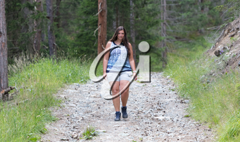 Hiker, young woman walking on footpath, Austria