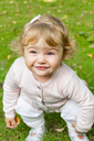 Photo of beautiful cute smiling infant girl