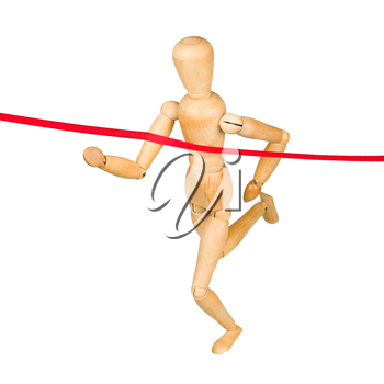 Wooden mannequin running through finishing line. Isolated on white.