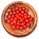many red cherry tomatoes in wooden bowl