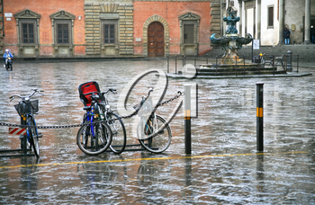 bicycle on Piazza Santissima Annunziata in Florence in rain