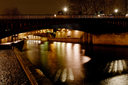 pont au Double and Seine river in Paris at night