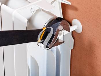 adjustable wrench and adjustment of heating radiator
