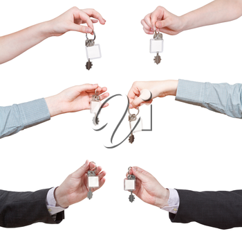 set of hands with blank door key ring isolated on white background