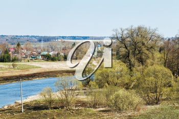 russian spring country landscape with church, village and Moskva River in Mozhaysk region
