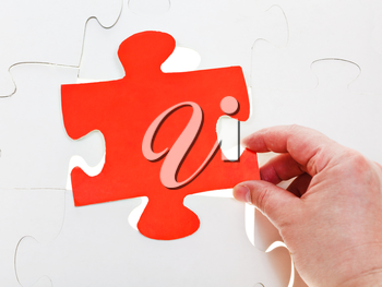 fitting red puzzle piece on free space in layer assembled puzzles