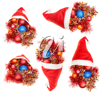 christmas gifts - set of red santa hats with xmas decorations on white background