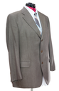 business suit on tailor mannequin - green woolen jacket with shirt and tie isolated on white background