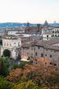 travel to Italy - view of houses of old Rome city from Capitoline hill in evening