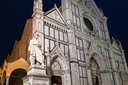 travel to Italy - statue of Dante Alighieri and Basilica di Santa Croce (Basilica of the Holy Cross) in Florence city in night
