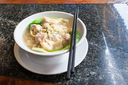 travel to China - Dim sum with noodle soup with chopsticks in chinese cafe in Yangshuo town County