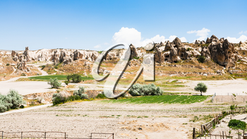 Travel to Turkey - rural scenery with ancient monastic settlement near Goreme town in Cappadocia in spring
