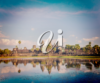 Vintage retro effect filtered hipster style image of Cambodia landmark Angkor Wat with reflection in water