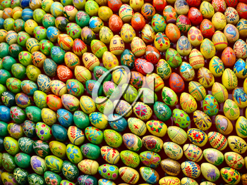 Multicolored easter eggs taken closeup as background.