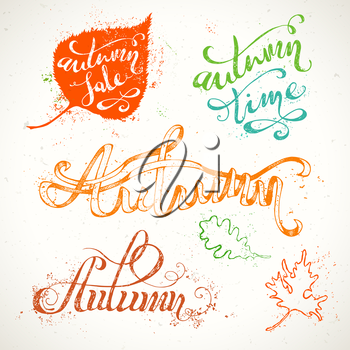 Grunge colourful words and leaves isolated on white background. Paint stains. Autumn. Autumn Sale. Autumn Time.