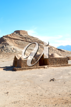 blur in iran near yazd the antique zoroastrian temple abandonated house and contruction