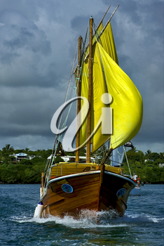 tropical lagoon hill navigable  froth cloudy  pirate boat  and coastline in mauritius