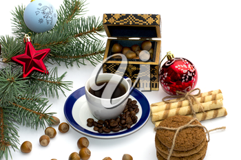 fir-tree branch with ornament, a trunk, sweets and nutlets, the subject Christmas and New Year