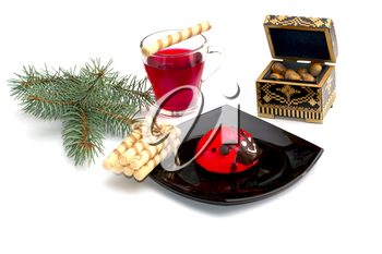 plate with red cake, tea, nutlets and a coniferous branch, a still life, the subject Christmas and New Year