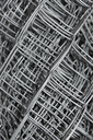 Steel mesh with water drops composed in multiple layers close-up