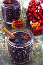 Crystal goblet with mulled wine and cinnamon stick in it,decorated with star anise
