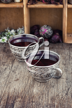 Medicinal tea a decoction of hibiscus tea in stylish cups.