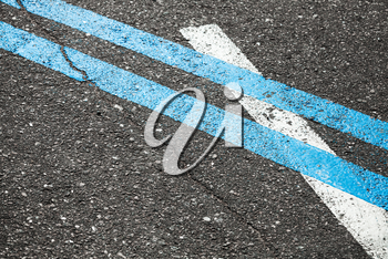 Blue double dividing line over one white on highway asphalt, closeup photo