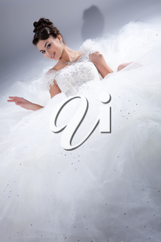 Young beautiful dark-haired woman in a wedding fashionable dress