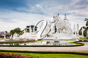 Wat Rong Khun (White Temple) is a contemporary art exhibit in the style of a Buddhist temple in Chiang Rai, Thailand
