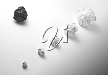 Concept of crumpled paper balls on white
