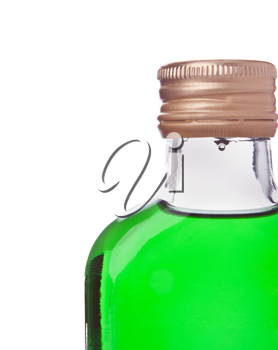 Close-up of a bottle with green alcohol