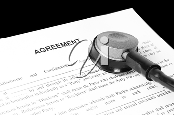 Examination of the business agreement. Isolated on black