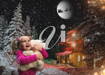 Cute girl at home holding toy bear outside in winter