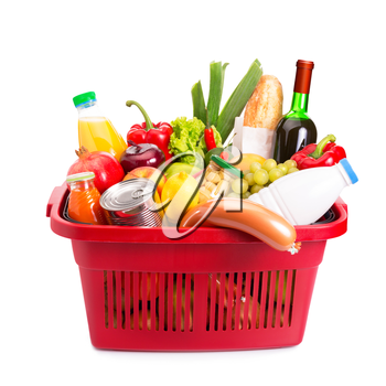 Basket full off fruits and vegetables. Isolated over white.