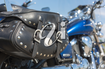 Motorcycle with a leather saddle bag
