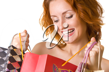 Great shopping. Smiling woman looking into the bag