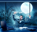 Scared businessman in the office, full moon outside