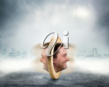 Male face on two sides of the coin is spinning over grey foggy background