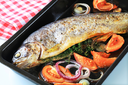 Herb-stuffed trout with tomatoes and onion